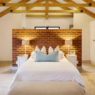 Inspiration for a beach style bedroom in Other with white walls and concrete floors.