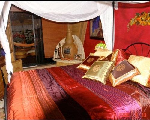 Camera da letto etnica con camino ad angolo foto e idee per arredare - Camera da letto con camino ...
