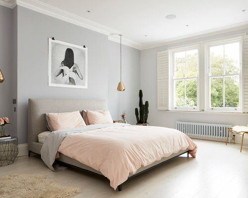 Contemporary Bedroom In London With Grey Walls And Light Hardwood Flooring.