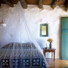 Mediterranean Bedroom by Deborah French Designs