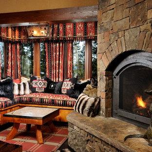 Ejemplo de dormitorio ecléctico con paredes multicolor, chimenea tradicional y marco de chimenea de piedra