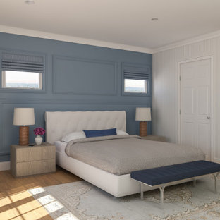 Mid-sized transitional guest bedroom in Seattle with white walls, medium hardwood floors, no fireplace and yellow floor.