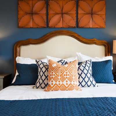 Example of a transitional bedroom design in Houston with blue walls