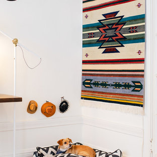 Inspiration for an eclectic medium tone wood floor bedroom remodel in San Francisco with white walls