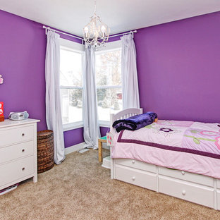 Inspiration for a mid-sized arts and crafts bedroom in Grand Rapids with purple walls, carpet and brown floor.