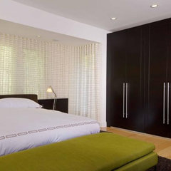 modern bedroom by Hughes Construction, Inc