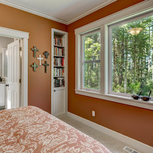 This is an example of a mid-sized arts and crafts master bedroom in Seattle with carpet, orange walls, no fireplace and grey floor.
