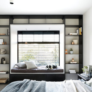 Inspiration for a modern bedroom in Melbourne with white walls, carpet and grey floor.