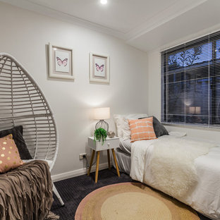 This is an example of a transitional guest bedroom in Perth with grey walls and carpet.