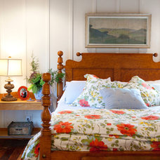 Rustic Bedroom by C.H.I. Construction, Inc.