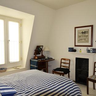 Foto de dormitorio tipo loft, actual, grande, con paredes blancas, suelo de madera pintada, chimenea tradicional y marco de chimenea de yeso