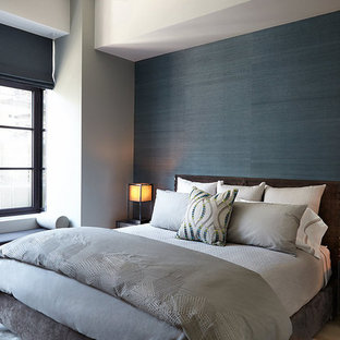Bedroom - mid-sized contemporary guest multicolored floor bedroom idea in New York with black walls and no fireplace