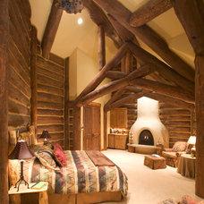 Rustic Bedroom by Sitka Log Homes