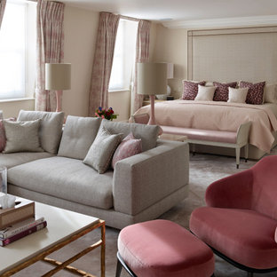 Inspiration for an expansive classic master bedroom in London with beige walls, carpet and beige floors.