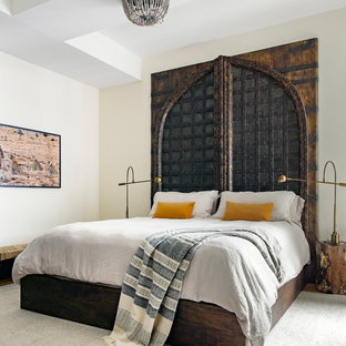 Inspiration for an eclectic master bedroom remodel in New York with white walls