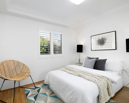 Inspiration For A Modern Guest Bedroom In Sydney With White Walls, Laminate  Floors, No