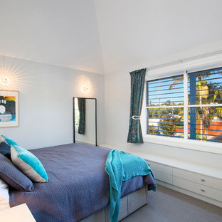 Contemporary guest bedroom in Sydney with white walls, carpet, no fireplace and grey floor.