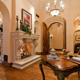 Design ideas for an expansive traditional master bedroom in Phoenix with beige walls, medium hardwood floors, a two-sided fireplace and a stone fireplace surround.