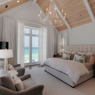 Bedroom - large beach style light wood floor bedroom idea in Miami with white walls