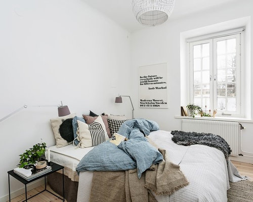 Mid Sized Scandinavian Master Light Wood Floor Bedroom Idea In Stockholm  With White Walls Part 49