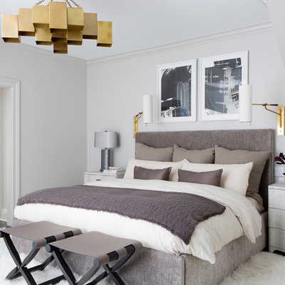 Transitional dark wood floor and brown floor bedroom photo in New York with white walls