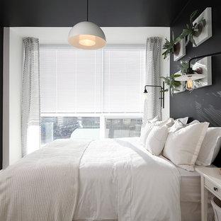 Foto di una camera da letto minimal con pareti nere