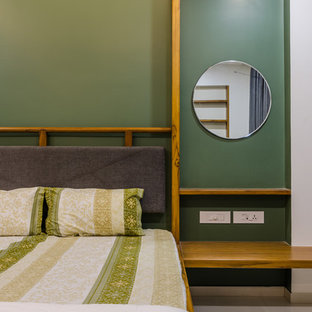 Example of an asian gray floor bedroom design in Other with green walls