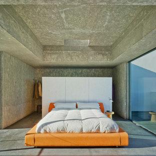 Diseño de dormitorio industrial con suelo de cemento