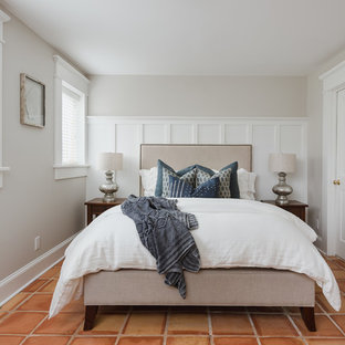 Inspiration for a beach style guest orange floor bedroom remodel in Charlotte with gray walls