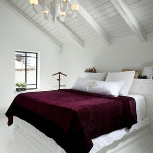 Design ideas for a contemporary bedroom in Tel Aviv with painted wood floors and white floor.