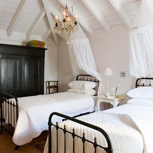 Inspiration for a mid-sized timeless guest ceramic tile bedroom remodel in Barcelona with white walls and no fireplace