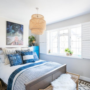 Design ideas for a medium sized beach style bedroom in London.