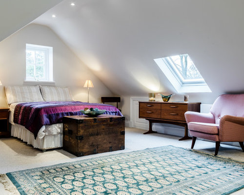Medium Sized Contemporary Guest Bedroom In London With White Walls And  Carpet.