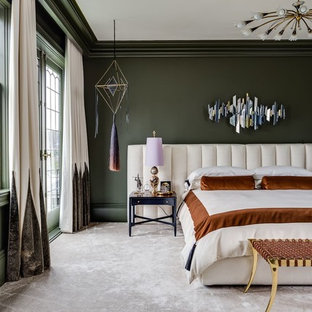 Photo of a large transitional master bedroom in Boston with green walls, carpet and beige floor.
