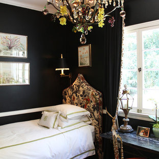 Eclectic bedroom photo in Los Angeles with black walls