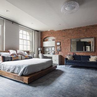 Foto de dormitorio urbano con moqueta y suelo azul
