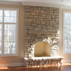 Contemporary Indoor Fireplaces by Heartstone Custom Builders