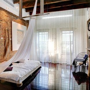 Foto de dormitorio industrial con marco de chimenea de baldosas y/o azulejos y chimenea tradicional