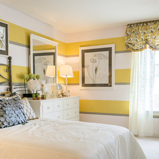 Example of a mid-sized classic guest carpeted and white floor bedroom design in Austin with multicolored walls