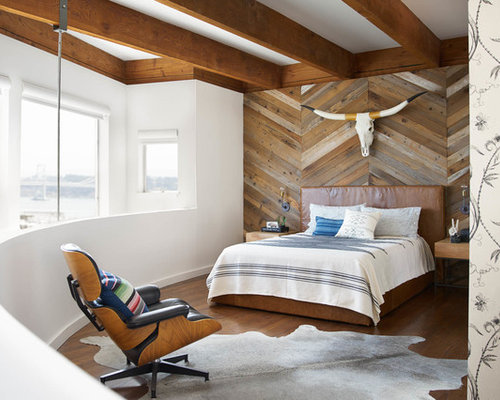 Inspiration For A Contemporary Loft Style Medium Tone Wood Floor And Brown  Floor Bedroom Remodel
