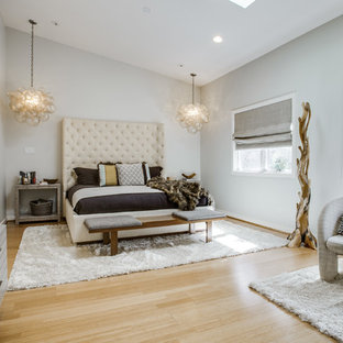 Inspiration for a large contemporary master bedroom remodel in Dallas with white walls and no fireplace
