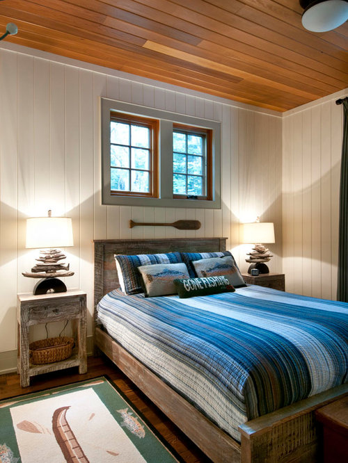 Example Of A Mountain Style Bedroom Design In Toronto With White Walls
