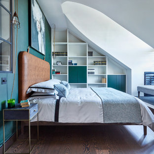 Medium sized contemporary master bedroom in London with dark hardwood flooring, brown floors and green walls.