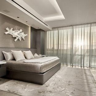 Cette image montre une chambre design avec un mur gris, un sol gris et un plafond décaissé.