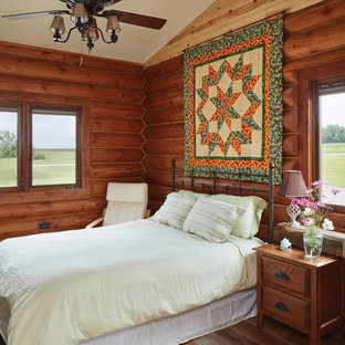 Inspiration For A Rustic Guest Medium Tone Wood Floor And Brown Bedroom Remodel In Other