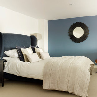 Inspiration for a small classic master bedroom in London with blue walls and carpet.