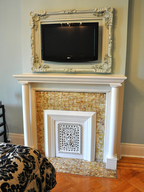 Example of a classic bedroom design in New York with a tile fireplace and a  standard