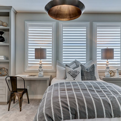 Inspiration for a transitional carpeted and gray floor bedroom remodel in Orange County with gray walls