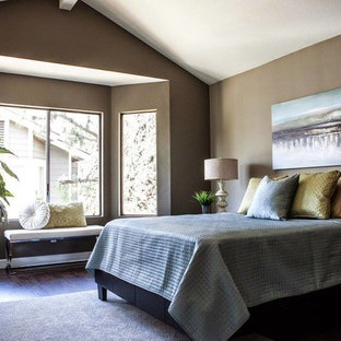 Inspiration for a large transitional master bedroom in Orange County with brown walls, vinyl floors and no fireplace.