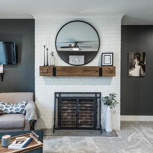 Imagen de dormitorio principal, de estilo de casa de campo, grande, con paredes grises, moqueta, chimenea tradicional, marco de chimenea de ladrillo y suelo beige